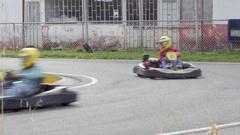 People driving karts on a kart track 4k Stock Footage