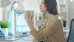 Young Woman Engineer Expects 3D Printed Part that She Just Made  Stock Footage