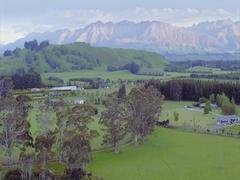 Aerial shot of countryside, farmland, new zealand Stock Footage