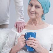 Oncology patient and person holding her arm Stock Photos
