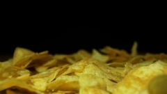 Man Takes the Potato Chips by hand on a Wooden Table on Black Background in Slow Stock Footage