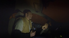 A man drinks a beer while driving a car. Stock Footage