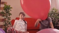 Family playing with balloons Stock Footage