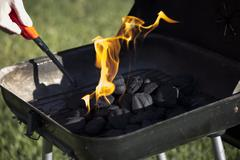 Charcoal Starting to Flame Stock Photos