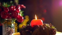 The flame of a decorative Christmas candle shakes during Christmas night Arkistovideo