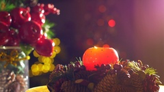 The shaking flame of a decorative Christmas candle is blown out causing smoke Stock Footage