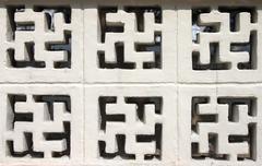 Buddhism Sign Brick Stock Photos