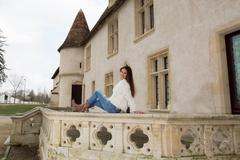 Tourism picture a woman, a girl in front of an ancient castle during touris.. Stock Photos