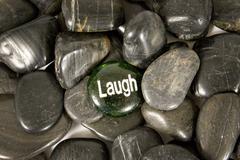 Laugh Encouragement Stone on River Rocks Kuvituskuvat