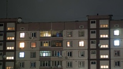 Multistorey Building With Changing Window Lighting At Night Stock Footage