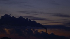Winter sunrise over the city. Smoke belching from the chimney. Stock Footage