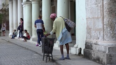 Сuban beggar woman at the Old Havana. Cuba Stock Footage