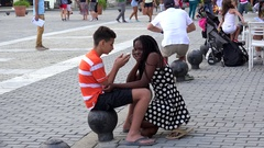 Black girl & white boy at the cobbled pavement of the Plaza Vieja. Havana, Cuba Stock Footage