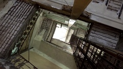 Typical dark dilapidated  stairwell of an apartment colonial house in Havana Stock Footage