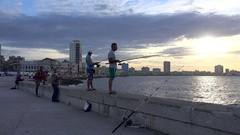 Cuban fishermen at the Havana malecon at evening. Stock Footage