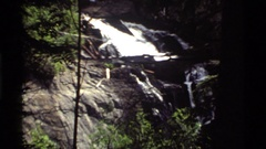 1972: rock wedge, boulder and manmade partition divide waterfall into smaller Stock Footage