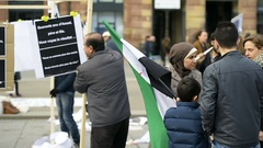 Kid waving flag as Syrian diaspora protesting against Bashar regime Stock Footage