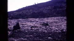 1972: flat lava flow with hills beyond IDAHO Stock Footage