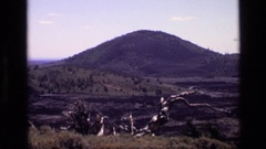 1972: a view of a group of dark mountain tops over a landscape IDAHO Stock Footage