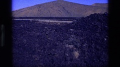 1972: a large area with lots of stones and a mountain around IDAHO Stock Footage