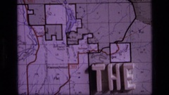 1973: ending title in blocky letters against an old, creased map SCAPEGOAT Stock Footage