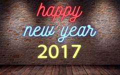 Happy new year 2017, flickering blinking neon sign on brick wall and wood b.. Stock Illustration