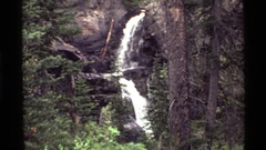 1972: stair-step waterfall over a rock substrate in a forest HOLLAND LAKE Stock Footage