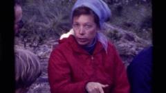 1972: people sitting outside talking HOLLAND LAKE MONTANA Stock Footage