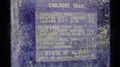 1977: an old sign for chilkoot trail in the state of alaska, usa ALASKA Stock Footage