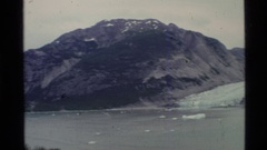 1977: camera pans from right to left across a view that includes mountains Stock Footage