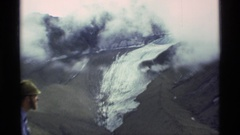 1977: a patch of snow sits on the dirty surface of a mountain ALASKA Stock Footage