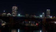Boston Skyline at Night with Subway Crossing Bridge Stock Footage