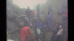 1977: a group of people enjoying their tour in the middle of mountain area Stock Footage