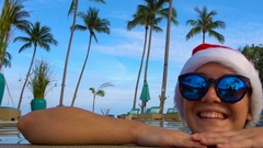 Woman in Santa Claus Hat in Pool. Celebrating New Year and Christmas in Hot Stock Footage