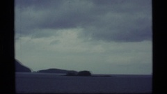 1977: panorama view of the ocean and a volcano. ALASKA Stock Footage