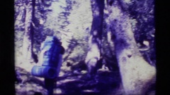 1977: hiker with large back pack looks for and discovers the sign  Stock Footage
