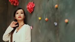 Vietnamese young brunette girl with long hair posing against the wall with Stock Footage