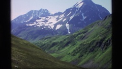 1977: three steep snow covered mountains high in the sky ALASKA Stock Footage