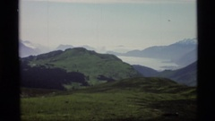 1977: panoramic view of a lush mountain region overlooking a nestled village by Stock Footage