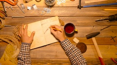 Something going wrong. Craftsman spilled tea on the work table. Top view. Stock Footage