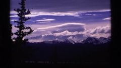 1977: mountains with snow under heavy clouds ALASKA Stock Footage
