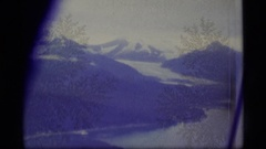 1977: aerial of mountains, snow, lake, forests ALASKA Stock Footage
