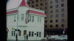 "1977: a bar named ""club 24"" sits on a corner in a city ALASKA Stock Footage"