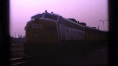1977: looking into the red colored train with name,logo and number in the front Stock Footage