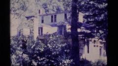 1977: tree covered houses ALASKA Stock Footage