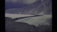 1977: a panoramic of a large patch of dirt and snow  Stock Footage