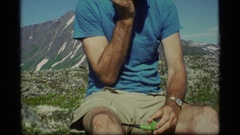 1977: a man scratching his face with a pipe in other hand ALASKA Stock Footage