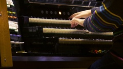 Female organist playing the organ Stock Footage