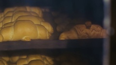 Croissants in the oven Stock Footage