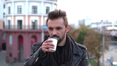 A good-looking man with a beard having takeaway coffee, smiling, Stock Footage